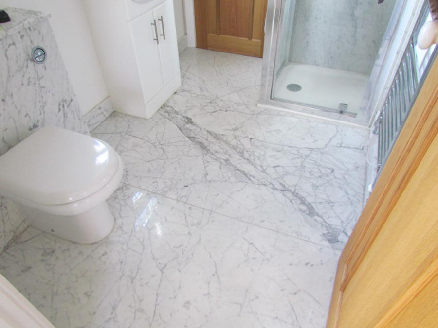 Marble Bathroom Flooring And Walls Carrara Marble Large Format Flooring  Laid Over Underfloor Heating In The Back Ground Showeru2026